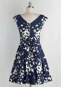 Ah, that familiar pitter-patter of the heart you feel after slipping into this butterfly-print frock by Closet London! With a bow-adorned back and a playful, pleated skirt, this navy-blue and white A-line makes you fall in love over and over again.