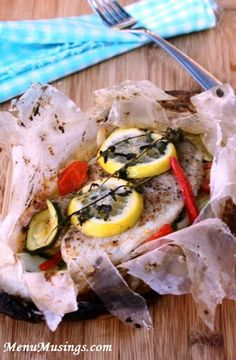 Tilapia en Papillote - Here's a lighter dinner that's healthy and delicious, very little fat.  It's filled with lean flaky fish, lots of fresh veggies, and tons of flavor!  Step-by-step photo tutorial.