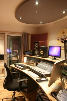 The Bunker control room, featuring an acoustic panels system and custom-made recording studio workstation.