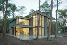 Modern Villa Kerckebosch Taking In A Forested Landscape in the Netherlands - http://freshome.com/2015/01/12/modern-villa-kerckebosch-taking-in-a-forested-landscape-in-the-netherlands/