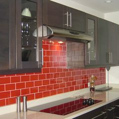 Red Glass Subway Tile Backsplash - Subway Tile Backsplash Design Ideas + Installation Tips [Enthusiast Home] Glass Subway Tile Backsplash, Grey Backsplash, Subway Tiles, Backsplash Design, Backsplash Ideas, Bathroom Red, Bathroom Wall Decor, Red Kitchen, Kitchen Backsplash
