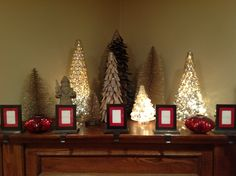My mantle, I am into trees this holiday season! Still need to put photos in our stocking holders :o)  #HowDoYouHoliday
