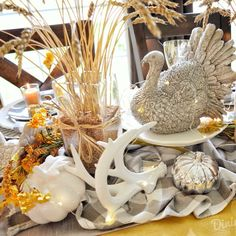 The tablescape I created for Thanksgiving this year was inspired by a recent ad by Pier 1 Imports (yes, again!) which included shades of o. Thanksgiving Table Settings, Thanksgiving Centerpieces, Seasonal Decor, Fall Decor, Wheat Centerpieces, Square Glass Vase, Fall Vignettes, White String Lights, Turkey Colors