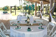 """I kept the guest tables simple yet stunning. White table cloths, burlap runners, 9"""" wood slab, and unique centerpiece designed exclusively for this event made these tables the talk of the night."""