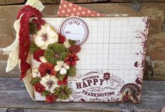 """""""Grateful""""  Mini Album by Stacy Rodriguez combines the beautiful Holiday paper from Authentique with the recycled cotton paper Darjeeling flowers from Petaloo!  Stop by our Blog to see how to make of of these EASY MINI ALBUMS for the holidays!"""