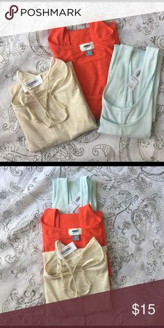 Old Navy 3 Tank Bundle (NWT) Tanks are 90% Cotton 5% Spandex. Tanks are various styles, fitted, relaxed and Cami. The Bone colored Cami is Fitted size XXL. The remaining tanks are  XL. The mint tank has a ribbed texture. The orange tank is a relaxed fit with a rounded hem. This is a basic staple that can be  used year round. Pick up your bundle now.  Tanks are NWT. Old Navy Tops Tank Tops