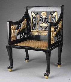 A Rare Egyptian Revival Carved, Ebonized and Gilded Child's Chair, late 19th c., the back and arms with animal figures and symbols, original herringbone woven string seat raised on animal paw legs, in a fine state of preservation with original ebonization and gilt, height 23 1/2 in., width 16 in., depth 13 1/2 in.