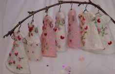 All of my tiny hand knit and embroidered Valentine's Day dresses for Amelia Thimble and Fairyland Pukipuki dolls, Cindy Rice Designs.