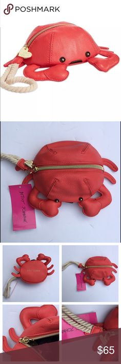 """Betsey Johnson Crab Wristlet  Adorable Betsey Johnson wristlet in a cute crabby shape. Made by faux leather. Wrist strap with 4-1/2"""" drop. The size of this wristlet is about 7.5""""✖️7"""". Top zip closure. Exterior features gold-tone hardware. Sold out in stores. NWT. Color: red/carol. The silhouette in the last picture is about 5'5"""" tall. Betsey Johnson Bags"""