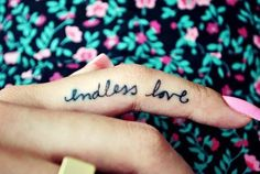 tattoo finger love cursive text