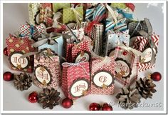 Scrapbook paper gift bags... No directions, but beautiful idea