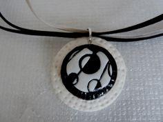 Pendentif de lentilles superposées sutton slice noir et blanc et structure