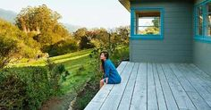 Woman sitting on deck looking at the view | Trinette Reed/Getty Images USDA RURAL DEVELOPMENT MORTGAGE... LOOK INTO THAT!!