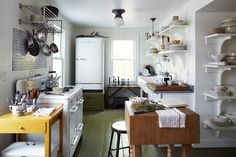White with pops of color, vintage sink, elevated fridge, deconstructed kitchen - by Phillip Ficks