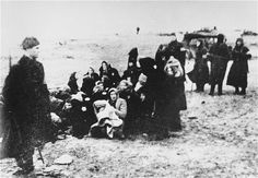 Members of the 21st Latvian Police Battalion assemble a group of Jewish women for execution