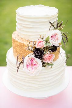 Gorgeous three tier cake with glittery gold center layer