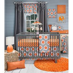 The Rhythm 3 Piece Crib Bedding Set is part of the new Rhythm Sweet Potato Collection by Glenna Jean The set includes a crib quilt orange dot fitted sheet and crib skirt Oranges greys and whites highlight the modern lines in this nursery