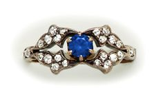 Sapphire, diamond, silver and gold ring.