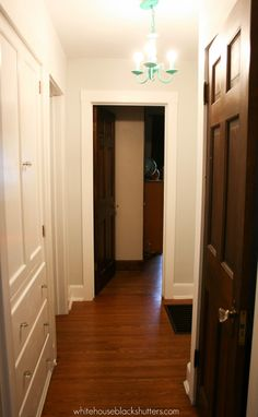 white trim with wood doors, you won't believe the before on this hallway!