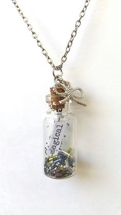 message in a bottle necklace, bottle charm necklace, message in a bottle jewelry, bow charms, bow pendants, pendant necklace, unique jewelry by Cthruglass on Etsy