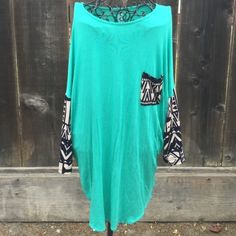 Oversized mint and Aztec long sleeve top New. Comes in small medium or large. Fits oversized. Let me know the size you need and I will make a separate listing. Sorry no trades, but feel free to make an offer ! Tops Tunics