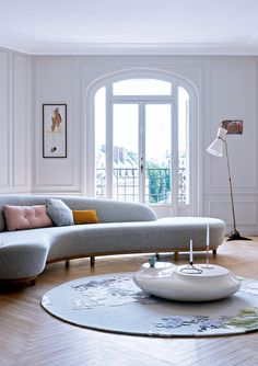 White living room with sky blue couch.