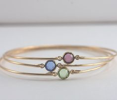 Choice of 3 Birthstone Gold Filled Bangle Bracelets  Price for 1 bangle is $20.00. With this listing, you receive 3 for $55.00.  A swarovski crystal