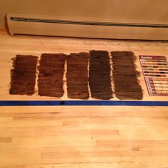 DuraSeal test stain on red oak: From left to right 1) 50/50 Jacobean/Dark Walnut, 2) Dark Walnut, 3) Jacobean, 4)Ebony, 5) 50/50 Jacobean/Ebony.  I was worried about going too light but ended up choosing Dark Walnut-2 in a satin finish--not too shiny and hides footprints rather than highlight them like glossy finishes can do.It feels as dark as I wanted. It is a very rich, warm color that allows the wood grain to show and doesn't feel cold like I was worried some of the more black colors…
