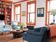 Terrific Farrow And Ball Paint decorating ideas for Fair Living Room Transitional design ideas with Antique Heart Pine Flooring BDDW bright orange trim built-in bookshelf cast iron Heart Pine Flooring, Pine Floors, Interior Decorating Styles, Interior Design, Decorating Ideas, Painted Window Frames, Bookshelves Built In, Bookcase, Down South