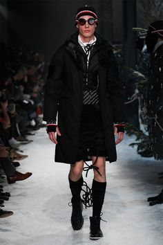 Moncler Gamme Bleu reflects the synergy of Moncler's expertise in active sportswear and outerwear with the hand-made tailoring sensibility of Thom Browne. The Fall/Winter 2017 collection is centered on the concept of mountaineering and hiking.