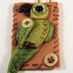 Green Parrot Wall Hanging - leather look polymer clay $20
