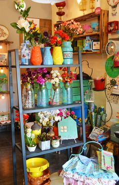 Thats how we roll, at #thewhistlingnest. Beating the heat with our flower power display idea. Home decor store, show window, display ideas, home products.