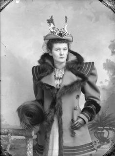 Portrait of Woman with Fur Coat: Studio portrait of a standing young woman, wearing a hat with a veil and flower, and a fur-lined coat. Victorian Photos, Victorian Women, Victorian Fashion, 1890s Fashion, Antique Photos, Victorian Era, Vintage Fashion, Vintage Pictures, Old Pictures