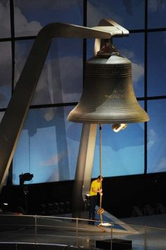Bradley Wiggins the first British winner of the Tour De France cycle race rings the largest harmonically tuned bell in the world to signal the start of the Opening Ceremony of the London 2012 Olympic Games at the Olympic Stadium on July 27, 2012 in London, England. (Stu Forster/Getty Images)  PHOTO LINK