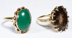"Lot 272: 10k Gold and Gemstone Rings; Two rings including an oval cut smokey quartz and an oval cut cabochon green gemstone; both marked ""10k"" inside band"