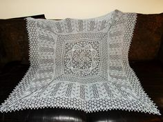 dscn0829 by RatgirlWH, via Flickr. Spanish  Armada pattern by MMario. Knitted Square shawl; free pattern