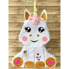 """Handcrafted pinata made from cardboard Size 26"""" Tall 17"""" Wide 4"""" Deep Holds Approx. 4-7 pounds of candy Sturdy enough for multiple guests to hit it Easy access opening on top to insert candy Weight resistant string (attached) for hanging SHIPPING: Will ship out from our shop within"""