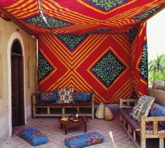 The outdoor curtain provides shade and atmosphere in the beautiful outdoor space.