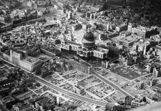 This is an aerial view of the city of London around St. Paul's Cathedral showing bomb-damaged areas in April of 1945.