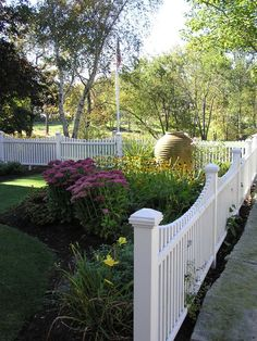 White neat fence in a front yard landscaping design