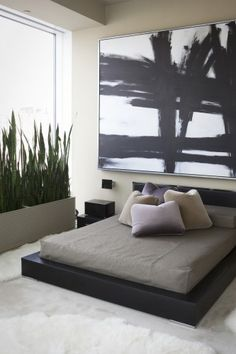 modern + masculine | platform bed + planter + fur rugs + large art