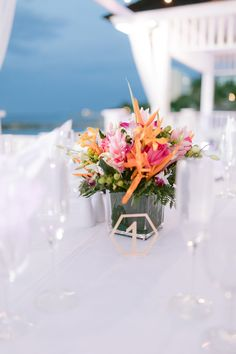 Tropical Wedding Centerpieces // A Colorful Jamaica Destination Wedding via TheELD.com Tropical Wedding Centerpieces, Destination Wedding Jamaica, Wedding Costs, Pastel Shades, Table Numbers, Videography, Fireworks, Bridal Hair, Wedding Planner