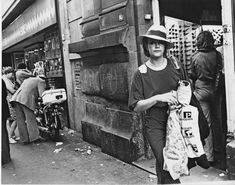 1970's. Lady shopping in the Kalverstraat in Amsterdam. The Kalverstraat is the most famous shopping street in the Netherlands. The street begins at Dam Square and ends roughly 750 meters down at the Munttoren near Muntplein. The street got the name Kalverstraat after the cattle market that was held there from 1486 until 1629. Photo Dolf Toussaint. #amstedam #1970 #Kalverstraat