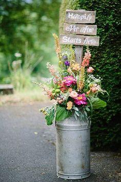 beautiful milk churn flower arrangements for the church with cute Happily Ever After Starts #churchweddingcandlesdecor