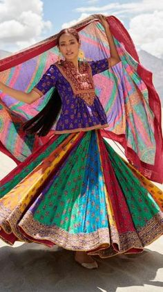 The purple choli of this ensemble features heavily embroidered burgandy yoke paired with a multi color embroidered lehenga & dupatta. Components: Blouse With Leheng Garba Dress, Navratri Dress, Anarkali Dress, Rajasthani Lehenga, Lehenga Dupatta, Choli Designs, Blouse Designs, Indian Dresses, Indian Outfits