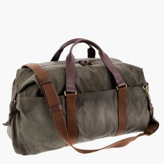 Every guy needs a great bag—something that will wear well and last for years. Looking stylish doesn't hurt either. This is that bag. Taking cues from vintage hunting gear, it's made from a rugged waxed cotton canvas with heavy-duty shoulder straps and extra reinforcements in key spots to help it withstand repeated use. It's tough, roomy and fit for all occasions—we actually think it's too good to be used just on the weekend. 8 handle drop. 17 1/2H x 26W x 9 1/4D. Adj...