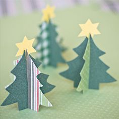 A tutorial for making Paper Christmas trees. Could be used as place cards for your Christmas dinner.