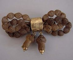 mourning jewelry : woven hair brooch.