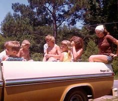 Riding in the backs of pickup trucks - We could get away with this in the era of no seat belts!