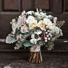 Winter wedding bouquet of mini cymbidium orchids silver brunia juniper pine boughs anemones pine cones garden spray roses seeded eucalyptus Vendela roses and dusty miller - March 02 2019 at Silver Winter Wedding, Winter Wedding Flowers, Winter Weddings, Autumn Wedding, Winter Flowers In Season, November Wedding Flowers, Small Winter Wedding, Evergreen Wedding, Snowy Wedding